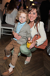 JILL HALFPENNY and her son HARVEY at a tea party to celebrate the launch of the limited edition Heart & Sole shoe collection by Step2wo in aid of the British Heart Foundation's Mending Broken Hearts Appeal, held at Aubaine on 2, Selfridge's, Oxford Street, London on 4th July 2012.