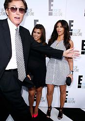 Bruce Jenner sprints through image of Kourtney Kardashian and Kim Kardashian at the E! Network Upfront event at Gotham Hall in New York City, NY, USA on April 30, 2012. Photo by Donna Ward/ABACAPRESS.COM  | 318565_031 New York City Etats-Unis United States