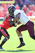 Southern Illinois Salukis tight end MyCole Pruitt (4) blocks Southeast Missouri State Redhawks defensive back Cantrell Andrews (24) in the first quarter. The Southern Illinois University - Carbondale (SIUC) Salukis defeated the host Southeast Missouri State University (SEMO) Redhawks 36-19 in an NCAA football game at Busch Stadium on Saturday September 21, 2013.