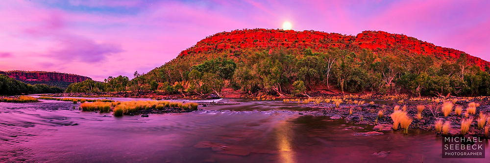 A stunningly beautiful scene of the Victoria River captured at dawn as the full moon was setting.<br /> <br /> Code: HATV0009<br /> <br /> 3:1 Panoramic print, available as a 40in (100cm) to 80in (200cm) Limited Edition Print. Edition size of 55.<br /> <br /> Add to Cart to view options and pricing.