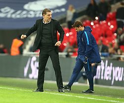 October 25, 2017 - London, England, United Kingdom - L-R West Ham United manager Slaven Bilic  and Tottenham Hotspur manager Mauricio Pochettino .during Carabao Cup 4th Round match between Tottenham Hotspur and West Ham United at Wembley Stadium, London,  England on 25 Oct  2017. (Credit Image: © Kieran Galvin/NurPhoto via ZUMA Press)