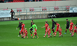 Bristol City players and their mascots make their way across the pitch at Ashton Gate Stadium - Mandatory by-line: Paul Knight/JMP - 01/10/2016 - FOOTBALL - Ashton Gate Stadium - Bristol, England - Bristol City v Nottingham Forest - Sky Bet Championship