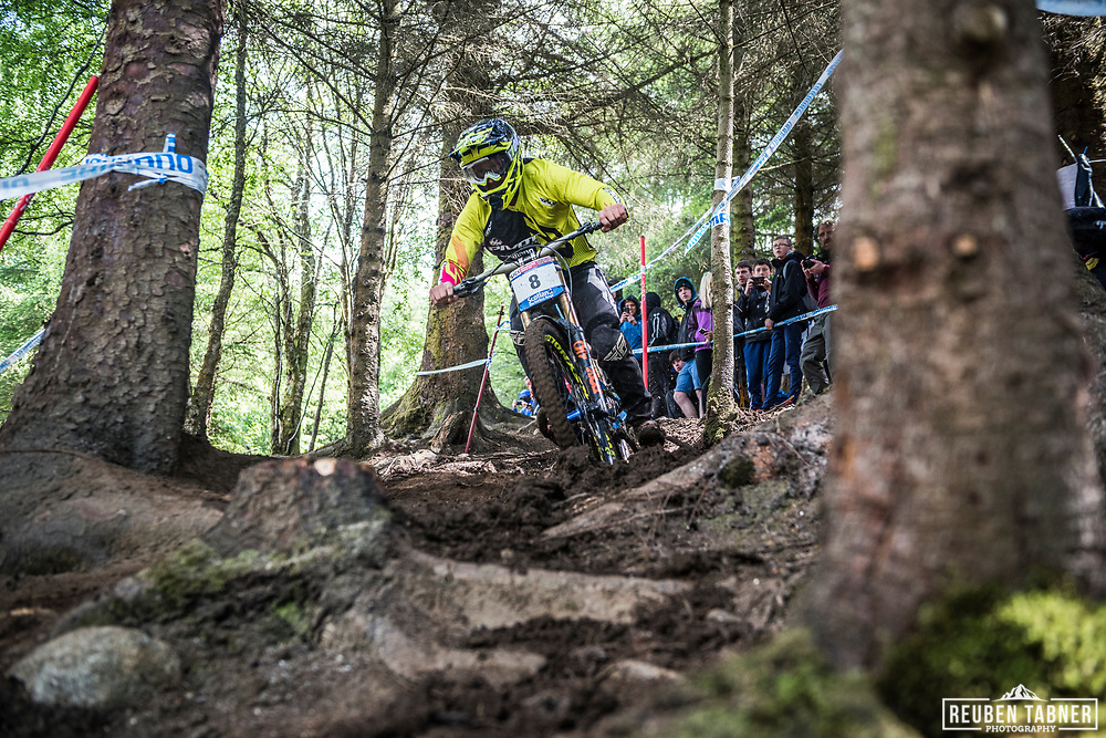 Rupert Chapman chops through the trees during his Qualifying Run at the UCI Mountain Bike World Cup in Fort William.