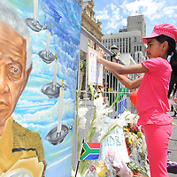 CAPE TOWN, SOUTH AFRICA - Saturday 7 December 2013, a young girl attached her condolence message to the barricade during a time of national mourning the death of the first democratically elected president, Nelson Mandela, in front of the Cape Town City Hall.<br /> Photo by Roger Sedres/ImageSA