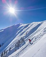 A skier drops into the Highland Bowl in Aspen, Colorado.