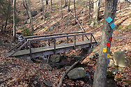 Mountainville, New York - Colorful trail markers are nailed to a tree near a bridge crossing over a Baby Brook on Schunnemunk Mountain on Nov. 28, 2010. on