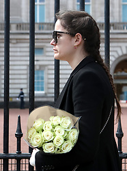 People wait in line outside Buckingham Palace, London, to leave flowers and to read the announcement of the death of the Duke of Edinburgh, who has died at the age of 99. Picture date: Friday April 9, 2021.