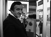 Minister Demonstrates New Payphone.   (N64)..1981..03.03.81..3rd March 1981..The Department of Posts and Telegraphs recently began installing new payphones to replace all existing public coinbox phones. It is now possible to dial trunk calls and in larger centres,International calls directly...Image shows the Minister for Posts and Telegraphs, Mr Albert Reynolds TD,demonstrating the new payphone at Elmcastle Walk, Kilnamanagh, Tallaght, Co Dublin