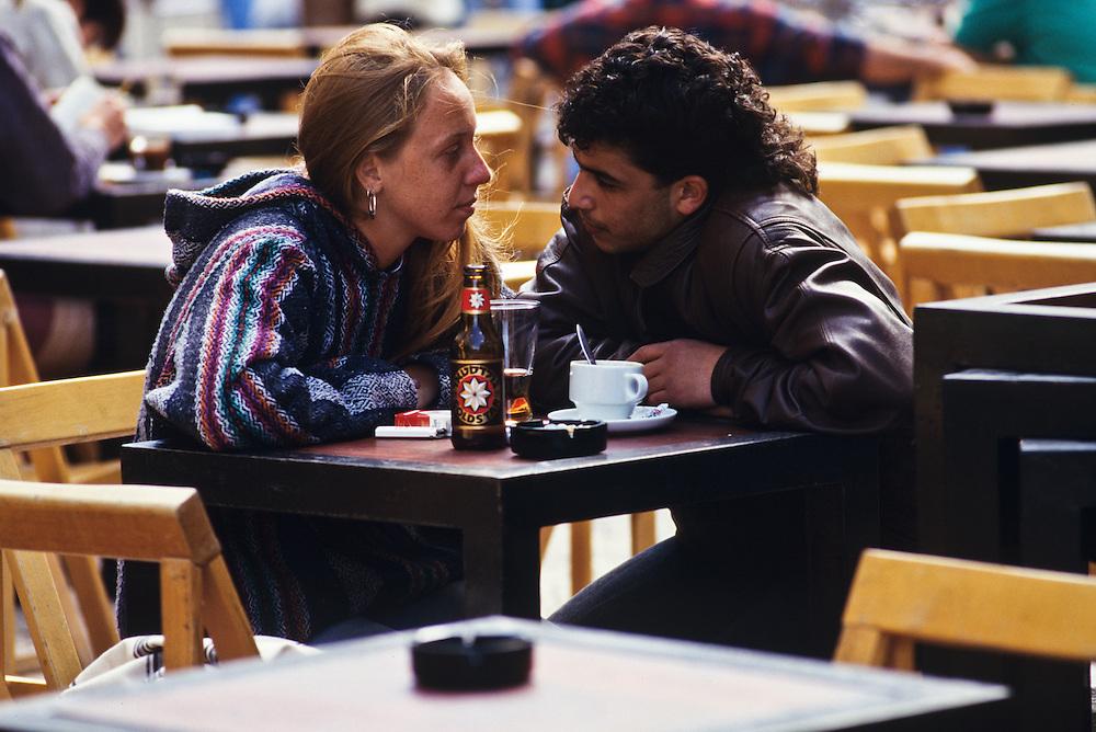 A couple enjoying a drink at a café in Jerusalem.
