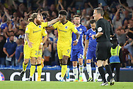 Bristol Rovers midfielder Stuart Sinclair (24) and Bristol Rovers forward Ellis Harrison (9) celebrate after scoring penalty 3-2 during the EFL Cup match between Chelsea and Bristol Rovers at Stamford Bridge, London, England on 23 August 2016. Photo by Matthew Redman.