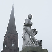 Burns Statue (Robert Burns was the town's most illustrious inhabitant) and Greyfriars Church, Dumfries, Dumfries and Galloway, Scotland.