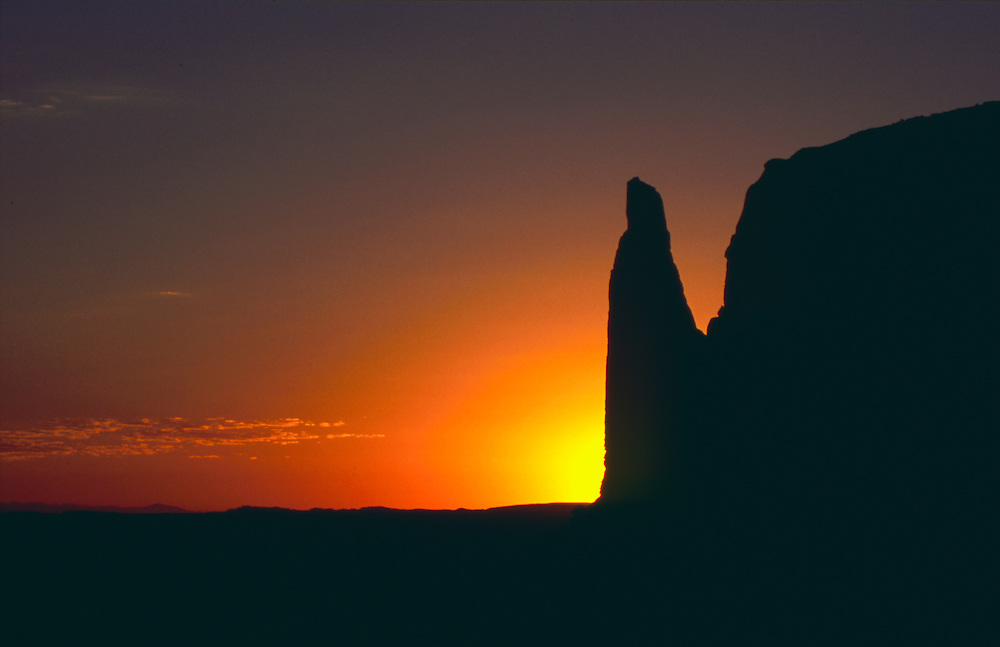 A spire on a butte in Monument Valley at sunset.