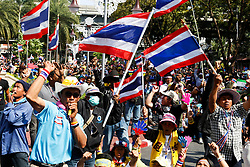 © Licensed to London News Pictures. 18/01/2014. Anti-Government Protestors cheer and blow whistles at the Royal Thai Police Head quarters in response to an explosive device reportedly injuring as many as 30 people and killing one yesterday during an anti-government street rally in Bangkok, Thailand. Anti-government protesters launch 'Bangkok Shutdown', blocking major intersections in the heart of the capital, as part of their bid to oust the government of Prime Minister Yingluck Shinawatra ahead of elections scheduled to take place on February 2. Photo credit : Asanka Brendon Ratnayake/LNP