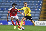 Oxford United forward Matty Taylor (9) battles for possession with Swindon Twn Defender Akinwale Odimayo (16) during the EFL Sky Bet League 1 match between Oxford United and Swindon Town at the Kassam Stadium, Oxford, England on 28 November 2020.