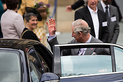 © Licensed to London News Pictures . 14/05/2015 . Liverpool , UK . The Prince of Wales waves as he leaves a visit with the Duchess of Cornwall to the World Museum in Liverpool . Photo credit : Joel Goodman/LNP