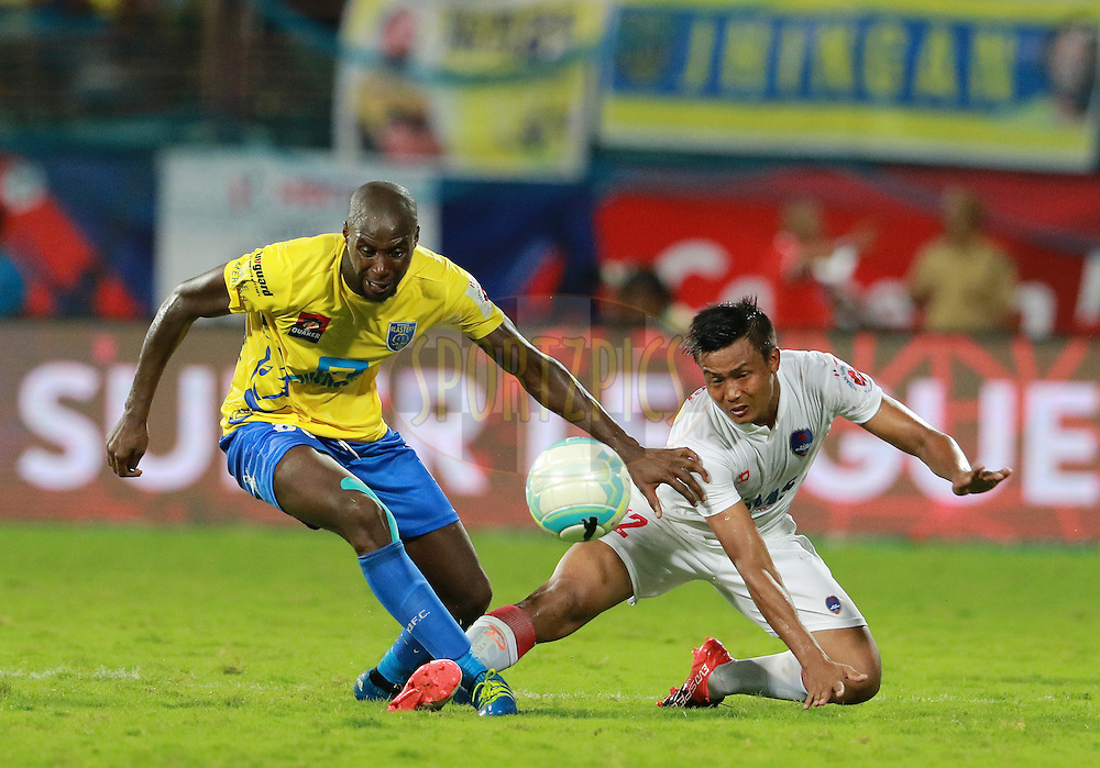 Azrack Mahamat of Kerala Blasters FC and Milan Singh Ongnam of Delhi Dynamos FC in action during match 9 of the Indian Super League (ISL) season 3 between Kerala Blasters FC and Delhi Dynamos FC held at the Jawaharlal Nehru Stadium in Kochi, India on the 9th October 2016.<br /> <br /> Photo by Vipin Pawar / ISL/ SPORTZPICS