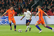 England midfielder Raheem Sterling battles with Netherlands Midfielder Kevin Strootman (Roma) and Netherlands Defender Matthijs de Ligt (Ajax Amsterdam),  during the Friendly match between Netherlands and England at the Amsterdam Arena, Amsterdam, Netherlands on 23 March 2018. Picture by Phil Duncan.
