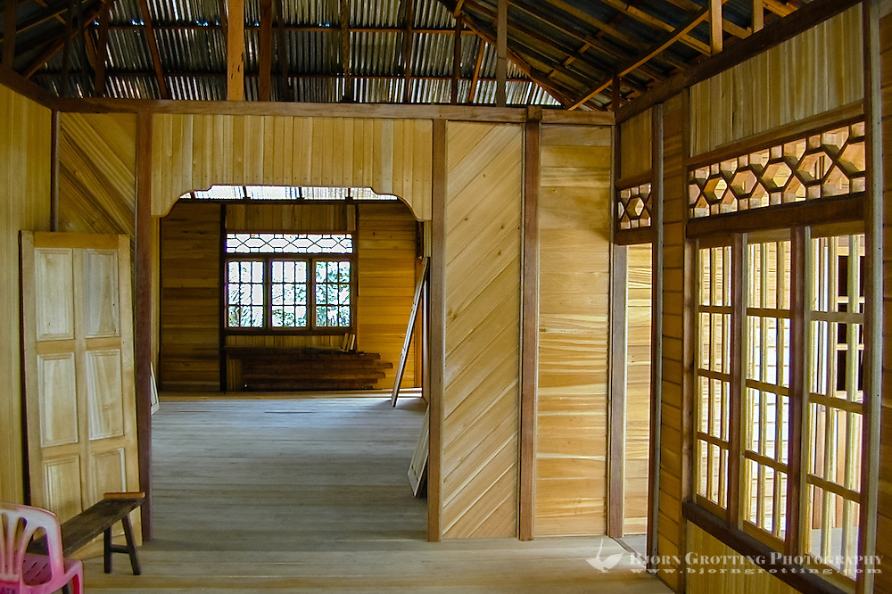 Indonesia, Sulawesi, Woloan. Just a few minutes west of Tomohon is the small village of Woloan. The speciality of Woloan is houses, which after completion are dismantled and shipped to the buyer.