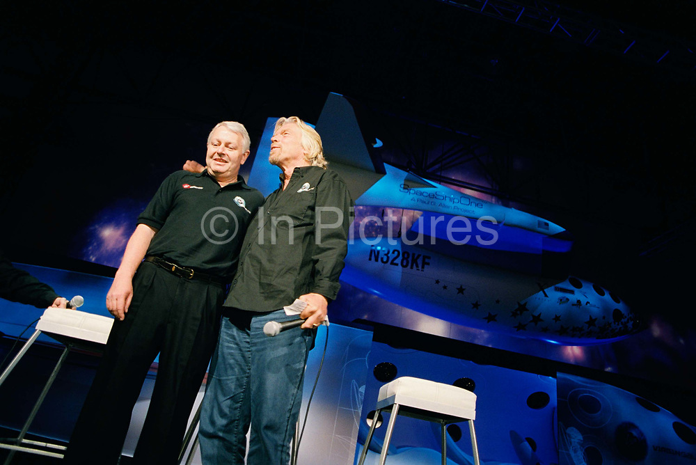 Frequent flyer astronaut Alan Watts is presented to the media and space industry commentators by Sir Richard Branson during the Wired NextFest science fair, at the Jacob K. Javits Convention Center, New York City in his north London home, England. Alan, 51, runs an electrical company and qualified for a free space space flight after being contacted by Sir Richard Branson's Virgin Galactic space company, having accumulated 2 million air miles on the Virgin Atlantic flight network. Aboard the re-usable space vehicle will be 6 passengers, each of whom will have paid $200,000 for the 40 minute flight to 360,000 feet (109.73km, or 68.18 miles) and to experience just 6 minutes of weighlessness. Flights start around 2009/10 at the new Philippe Starck-designed SpacePort America, New Mexico, USA. a 27 square mile, $225 million facility near Las Cruces.