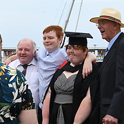 UK weather: Graduate Student taking picture with her family at Brighton seafront in UK on July 27 2018.