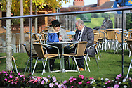 A couple arrive early and claim the first place on the Champagne Lawn prior to  the York Coral Sprint Trophy meeting at York Racecourse, York, United Kingdom on 12 October 2019.