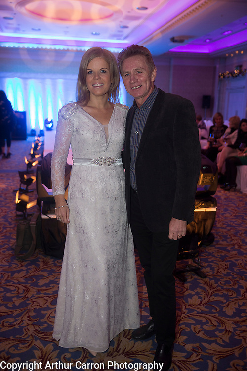 8/12/15 Marietta Dolan and Eamon Coughlan at the Oireachtas Christmas Charity Fashion Show in aid of Research Motor Neurone in the Shelbourne Hotel. Picture: Arthur Carron