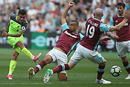 Philippe Coutinho of Liverpool (L) shoots and scores his teams second goal. Premier league match, West Ham Utd v Liverpool at the London Stadium, Queen Elizabeth Olympic Park in London on Sunday 14th May 2017.<br /> pic by Steffan Bowen, Andrew Orchard sports photography.