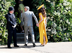 US actor George Clooney (C) and his wife British human rights barrister Amal Clooney (R) arrive for the royal wedding ceremony of Britain's Prince Harry and Meghan Markle at St George's Chapel in Windsor Castle, in Windsor, Britain, 19 May 2018. Photo by Lauren Hurley/ABACAPRESS;COM