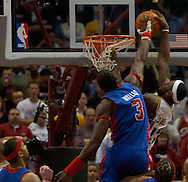 MORNING JOURNAL/DAVID RICHARD.LeBron James is rejected by Ben Wallace last night in the second half.