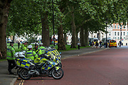 Police are seen barricading King Charles Street outside the Foreign & Commonwealth Office ahead of the Extinction Rebellion weeks of protests to start on Monday. Additional police forces including members of traffic police (L next to Motorcycles) as well as territorial support group (R in bokeh) are seen driving around central London on Sunday, Aug 22, 2021. (VX Photo/ Vudi Xhymshiti)