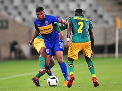 Cape Town--180401  Cape Town City midfielder Lyle Lakay challenged by  Zolani Nkombelo of Golden Arrows in a PSL game at the Cape Town Stadium. .Photographer;Phando Jikelo/African News Agency/ANA
