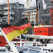 German flag on boat in docks of Hamburg port