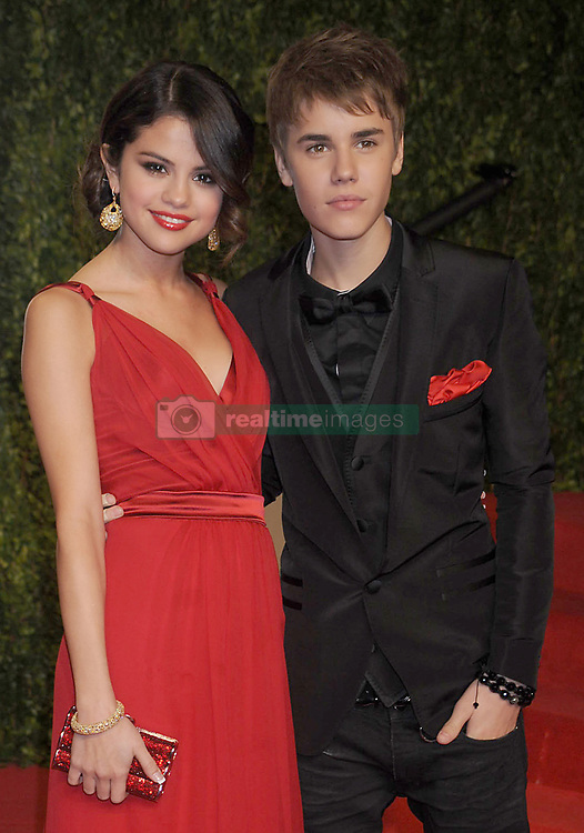 MIAMI, FL - AUGUST 07:  Young sweethearts Justin Bieber and Selena Gomez have reportedly broken up after the Disney star told Justin she didn't approve of his new hip-hop music friends. The Wizards Of Waverley Place star, who has been dating the Baby singer since the start of the year, has allegedly dumped the 17-year-old teen sensation because she is worried about the influence his new friends are having on him..In recent weeks, Justin has been spending more time publicly with Sean Kingston, rapper Lil Wayne, and singer Chris Brown who has a new song with the Canadian teenager. Chris Brown became a figure of notoriety after he attacked his ex-girlfriend Rihanna in 2009 which resulted with the Only Girl In The World singer having to go to hospital and Brown being charged with assault and making criminal threats. Lil Wayne meanwhile served eight months of a one year prison sentence in 2010 after pleading guilty to possession of a weapon. Justin has been friends with Jamaican singer Sean Kingston since they recorded the song Eenie Meenie together in April 2010 and last weekend when Justin and Sean were driving around South Beach in a Rolls Royce convertible, they were pulled over by a police officer who thought it was suspicious that two youngsters should be driving such an expensive car. Although the two boys didn't break any law and were allowed to continue driving, it is thought that Selena didn't like the attention that the incident drew to Justin. The final straw allegedly came when Justin took Sean to watch Selena perform that same weekend in Florida. A friend of Selena told the Sun newspaper: 'Selena told him to stop hanging with these bad people. She didn't want him to crash her gig. They had a huge row and said it was good they were having time apart while she was on tour.' However, Justin is said to have been devastated by her decision and was spotted in tears after one of their arguments.  The friend added to the newspaper: 'It's hard seeing a little 17-yea