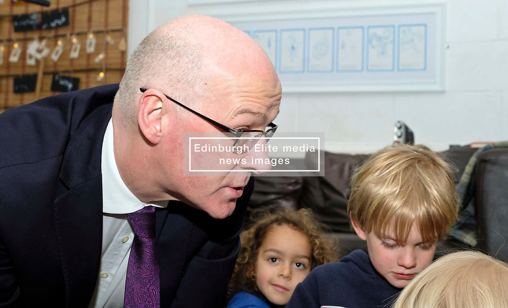 Pictured: Mr Swinney and Torrin Smith (aged four)<br /> Deputy First Minister John Swinney visited Cowgate Nursery in Edinburgh to meet children, staff and modern apprentices working in early years and childcare. Mr Swinney confirmed that a record number of early years apprenticeships are expected to start this year as part of the expansion of free nursery and childcare.  Mr Swinney toured the nursery and discussed the City of Edinburgh Council's plans to expand the early years and childcare workforce and met with modern apprentices as well as Jake Stefanovic, an ambassador from the Scottish Government's childcare recruitment campaign.<br /> <br /> <br /> Ger Harley   EEm 13 February 2018