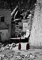 Monks wander through Drepung Monastery, Lhasa, Tibet.