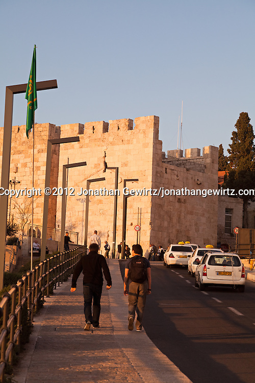 Pedestrians approach the Jaffa Gate of the Old City of Jerusalem. WATERMARKS WILL NOT APPEAR ON PRINTS OR LICENSED IMAGES.