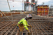 Mcc0084404 . Daily Telegraph<br /> <br /> Aeolus Satellite Launch<br /> <br /> Workmen on the construction site for the Ariane 6 launch pad , Europe's next generation heavy launcher should be operational in 2020 .<br /> <br />  . <br /> The Aeolus Satellite, designed and built by Airbus contains pioneering technology that will monitor winds around the globe that will change weather forecasting forever .<br /> <br /> Kourou, French Guiana 22 August 2018