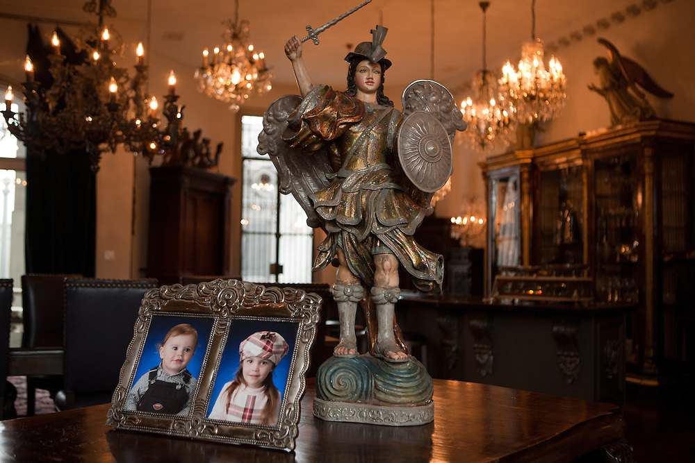 A small statue atop a table sits alongside pictures of Gertrude Zachary's grandchildren inside her home in downtown Albuquerque New Mexico. ..CREDIT: Steven St. John for The Wall Street Journal