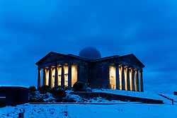 Edinburgh, Scotland, UK. 29 December 2020. Edinburgh wakes up to a wintry snow covered scene after a late night snowfall. View of the former City Observatory on Calton Hill, now the Collective art gallery.  Iain Masterton/Alamy Live News