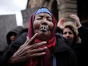 Una donna protesta durante la manifestazione, Riprendiamoci la città, organizzata dai movimenti del diritto all'abitare. Roma, 19 gennaio 2013. <br /> Christian Mantuano / OneShot