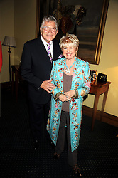 TV presenter GLORIA HUNNIFORD and her husband STEPHEN WAY at a reception to support The Hyde Park Appeal held in the officers Mess, Household Cavalry Mounted Regiment, Hyde Park Barracks, London SW1 on 10th November 2008.