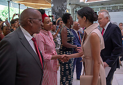 July 17, 2018 - London, London, United Kingdom - Image licensed to i-Images Picture Agency. 17/07/2018. London, United Kingdom. The Duke and Duchess of Sussex at Nelson Mandela exhibition in London. Pic shows: Meghan meets Nelson Mandela's granddaughter Zamaswazi Diamini-Mandela  (Credit Image: © Pool/i-Images via ZUMA Press)