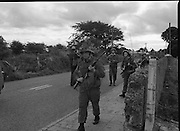 "Army Exercises In Co Sligo.   (L37).<br /> 1977.<br /> 05.09.1977.<br /> 09.05.1977.<br /> 5th September 1977.<br /> The Army Reserve Brigade, which is made up of regular units from the Southern Command, are conducting a series of conventional military exercises in counties Mayo and Sligo from the 5th to the 9th September. Approximately 1,500 men and 250 vehicles are involved. The exercise was codenamed ""Humbert"" after an ill fated expedition by French troops into Ireland on 23rd August 1798. 1,100 French troops with Irish support took on the incumbent English forces. After some initial success they were defeated at Ballinamuk on 8th Sept 1798 by the army of Cornwallis.<br /> <br /> Picture shows some soldiers taking up position during the military exercises."