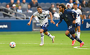 May 16, 2021 - Kansas City, KS, United States:   Vancouver Whitecaps midfielder Caio Alexandre (8, left) and Sporting Kansas City forward Gianluca Busio (10) chase a loose ball. Sporting KC beat the Vancouver Whitecaps FC 3-0 in a Major League Soccer game. <br /> Photo by Tim Vizer/Polaris