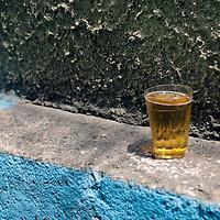South America, Brazil, Rio de Janeiro. A beer sits on ledge of corner at Favela of Vila Canoas.