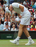 Tennis - 2017 Wimbledon Championships - Week Two, Wednesday [Day Nine]<br /> <br /> Men's Singles, Quarter Final match<br /> <br /> Andy Murray (GBR) vs. Sam Querrey (USA)<br /> <br /> Andy Murray's leg  feels the pain after a long rally in the fifth set on  Centre Court <br /> <br /> COLORSPORT/ANDREW COWIE