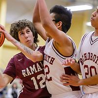 Ramah Mustangs Sean Diaz (12) presses into the Rehoboth Lynx defense Tuesday at Rehoboth High School.