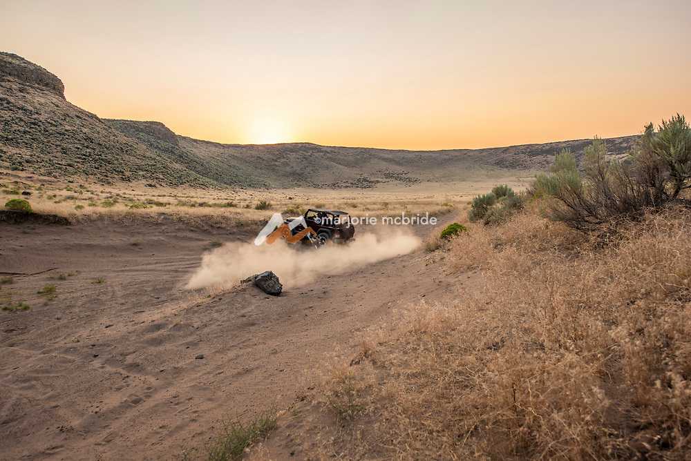 kicking up sand while jeeping during sunset at the Dietrich Crater in Dietrich, Idaho.