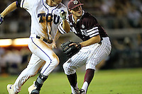 TCU's Connor Wanhanen (16) tries to outr run a throw to first base by Texas A&M's  Kyle Simonds during the eighth inning of a NCAA college baseball Super Regional tournament game, Saturday, June 11, 2016, in College Station, Texas. (AP Photo/Sam Craft)