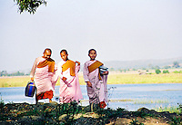 BURMA (MYANMAR) Shan State,Nyaungshwe. 2006. Three young friends return home. Most monks in Burma practice Theravada Buddhism, and as a whole, the Burmese people are unswerving in their belief.